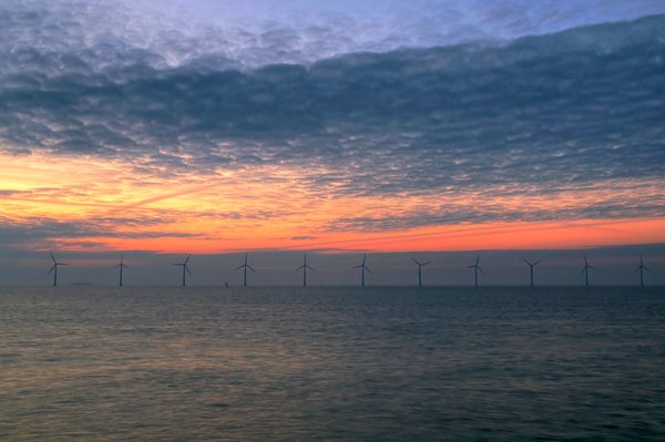 Oceanbased windturbines - HDR: Early morning before sunrise at the coast looking at windturbines. The picture is HDR.