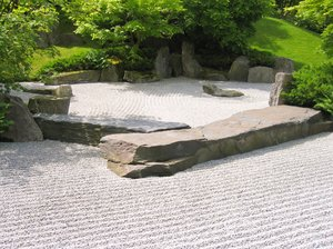 japanese garden 2: Unlike other traditional gardens, there is no real water present in Karesansui gardens. However, there is raked gravel or sand that simulates the feeling of water.