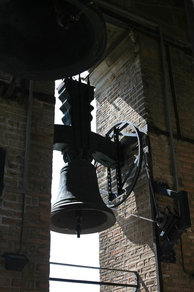 Tower bell: A bell with its tolling machinery in a cathedral tower in Spain.