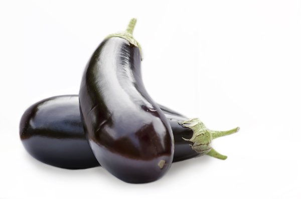 Aubergines: Purple aubergines isolated on white
