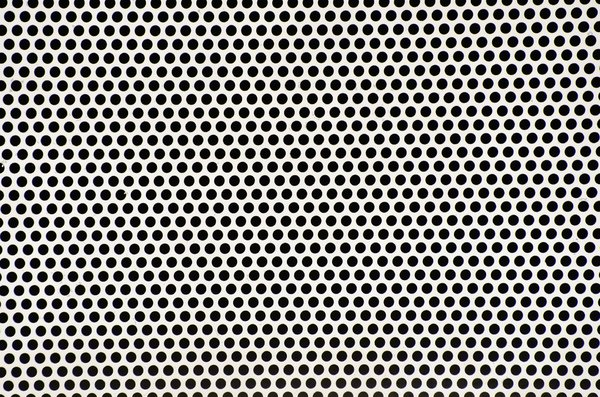 Metal grid texture: punched holes in a metal plate.