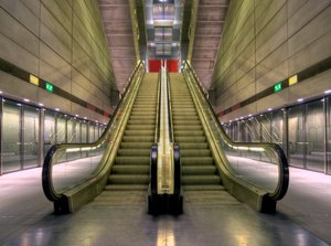 Subway escalator - HDR: Subway escalator (moving staircase) at a metro station in Copenhagen, Denmark. The image is HDR. The movement in the steps is not from the number of pictures gogin into the HDR but from the simple fact that the shuttertime even for the underexposed picture is long.