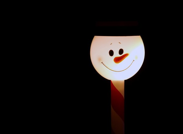 Illuminated snowman in a stick