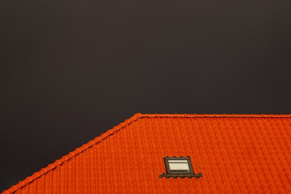 Red tiled roof against rainy s