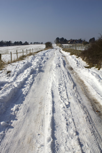 Snowy track: A farm track and public footpath on the South Downs, West Sussex, England, in February snow.