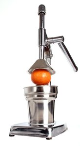 Freshly squeezed: The squeezer to squeeze freshly squeezed orange juice. Isolated.