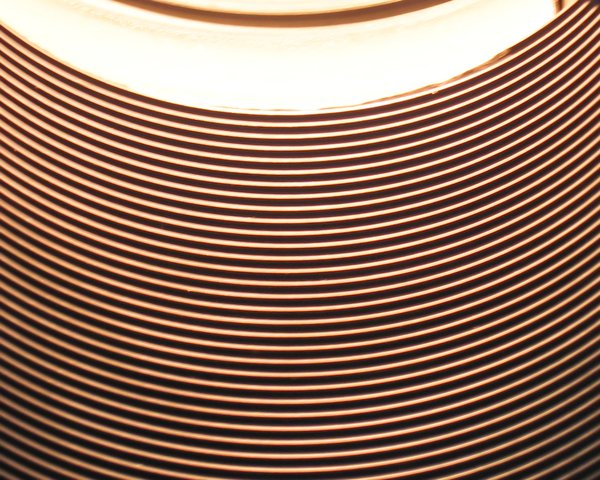 abstract circular texture: abstract circular texture (the interior of a small lamp)