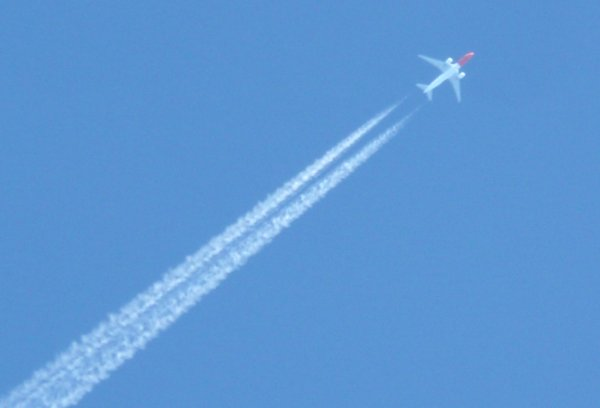 Airplane in the sky: Airplane with contrails