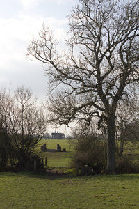 Nearly home: A farmhouse reached across fields and bridges in West Sussex, England.