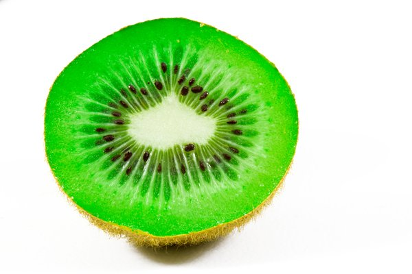 Open Kiwi Close-up: Open kiwi close-up isolated on a white background.