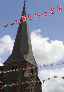 Union Jack bunting: Union Jack bunting to celebrate the Diamond Jubilee in front of a country church in Sussex, England.