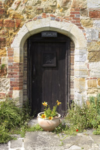 Old priory doorway: Old door in the stone wall of a mediaeval priory in Sussex, England. Photography on this estate was freely permitted.
