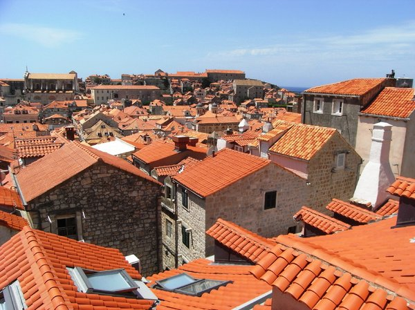 Old Dubrovnik town: Walking round the walled city views over the rooftops. Rebuilt rooftops following civil war. Great historical town to walk round.