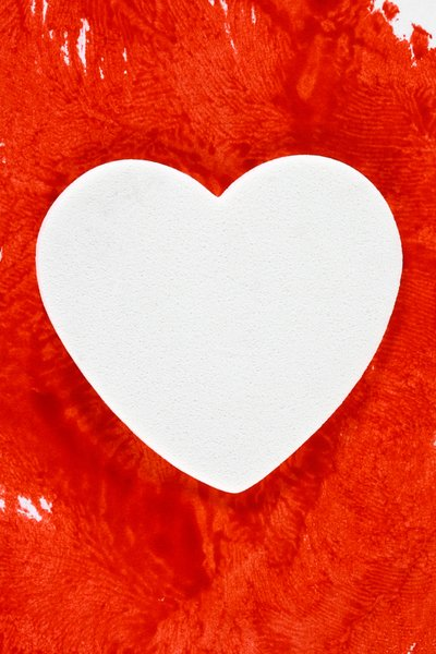 White Bleeding Heart: White foam heart on a background filled with fake blood.