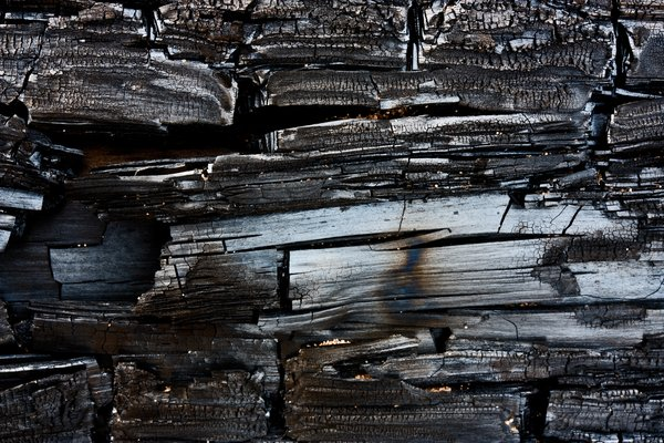 Charred Wood Texture: Close-up texture of charred wood.