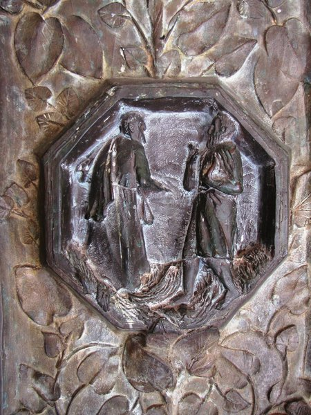 bronze image: Biblical motifs on a cathedral gate