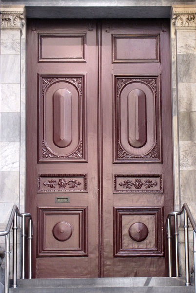 pillared doorway entrance3: historic government building with solid entrance doors on top of pillared steps