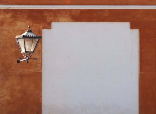 Advertisement board: Old wall with orange plaster and white advertisement board next to old fashioned lamp.