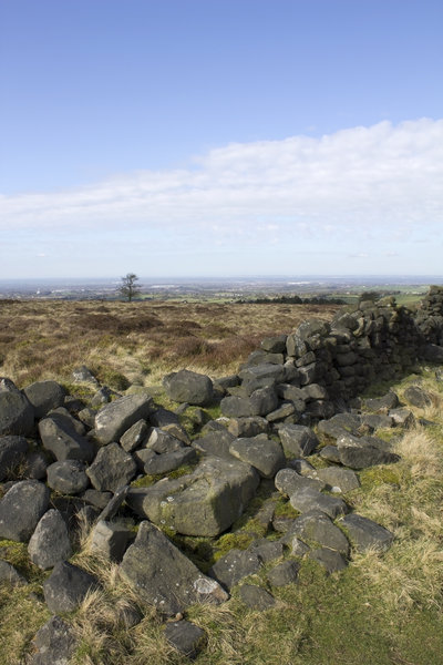 Moorland wall: An old ruined drystone wall on moorland in northern England.