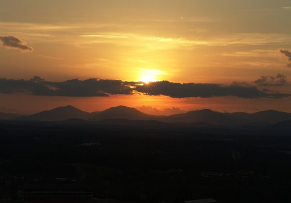 Golden sunset over valley: Sunset over the small town of Lynchburg, Virginia with George Washington Forest in the distance, mid spring.