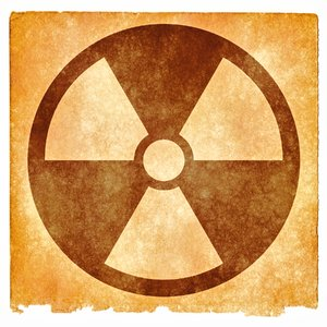 Nuclear Grunge Sign: Grunge textured nuclear symbol on vintage paper, with sepia toning for a more aged feel.