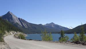 Lakeside road: A road by a lake in the Rockies, Canada.