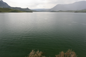 Moody green lake: A reservoir on a rainy day in southern Spain.
