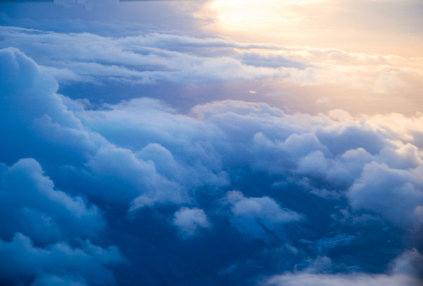Clouds from above: Just before dark, the setting sun seen from above