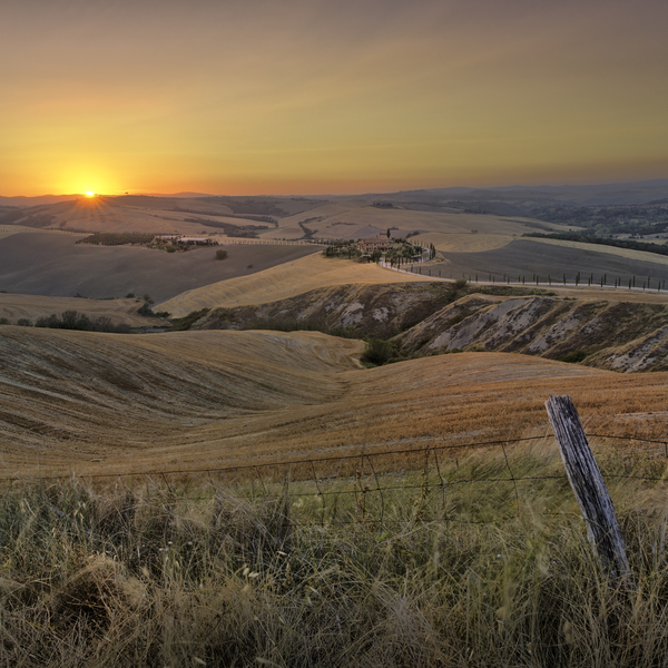 Farm in Tuscany: Farm and Farmland in the Hills of Tuscany, Sunset. Old Fence in Foreground.