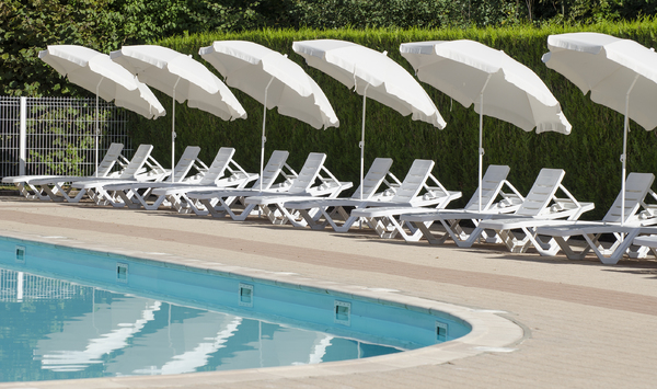 Lounge seats at the pool: pool side with umbrellas and seats
