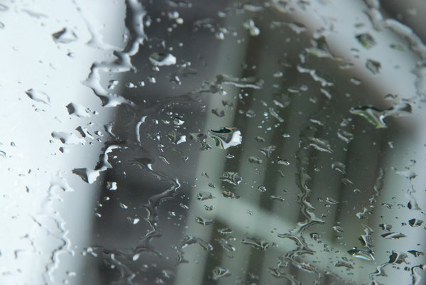 Rain on glass: Rain water droplets on a window