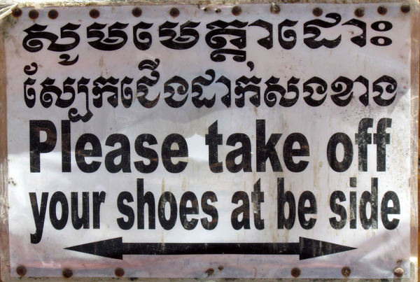 lost in translation: Cambodian temple sign asking for shoes to be removed