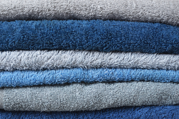 Fluffy Towels: A stack of freshly washed fluffy blue towels.