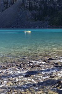 Canoe on blue lake