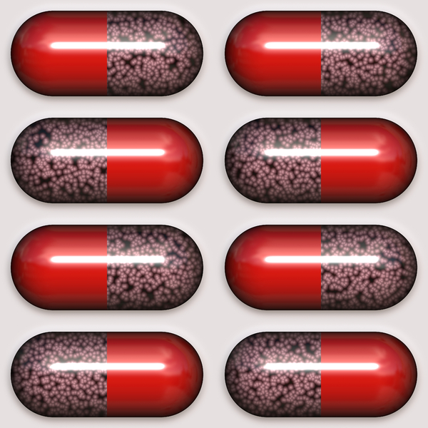 Medication Time 2: Red and clear tablets, capsules, or medication in clear plastic packaging. Perhaps you would prefer this image: http://www.rgbstock.com/photo/mhtN5KY/Medication+Time