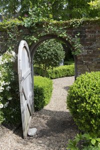 Garden gate: A wooden gate into an old walled garden in England.