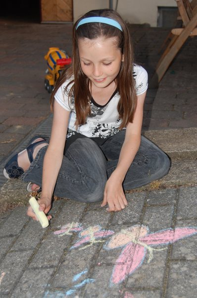 Pavement artist 1: Young girl using chalk to draw on a pavement. (She had permission!)
