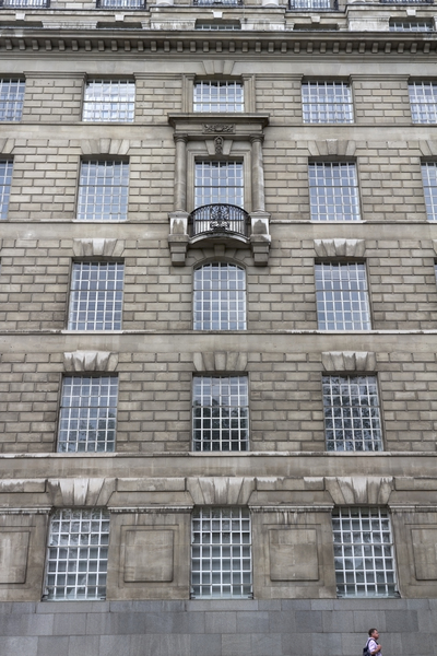 London architecture: Part of an old stone-clad office block in central London, England.