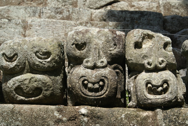 Three Mayan faces: Three Mayan faces carved in stone in Copan, Honduras