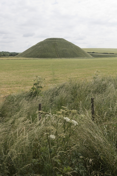 Silbury Hill: Silbury Hill, an ancient Neolithic artificial chalk hill, in Wiltshire, England.