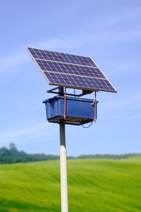 Small solar panel: A small solar cell panel in a field.