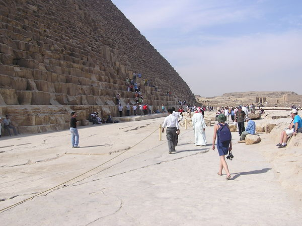 Tourists beside the pyramid