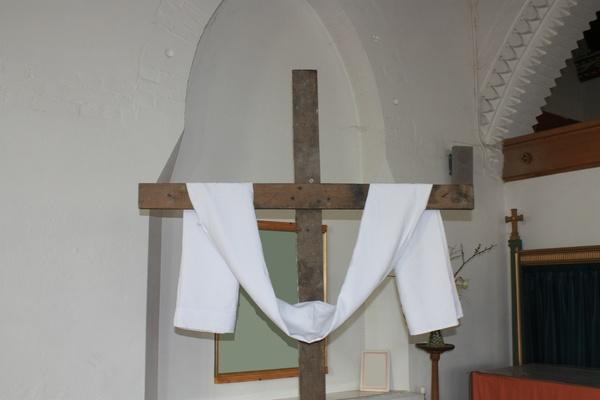 Cross draped, in a church
