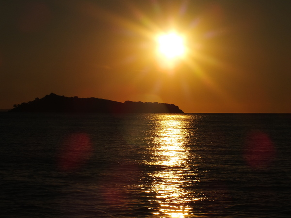 Island Sunset: Sunset over small island off Petra, Lesvos