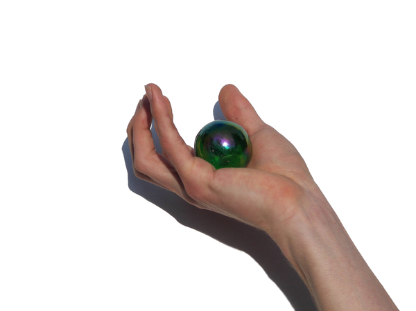 Hand holding a ball of glass