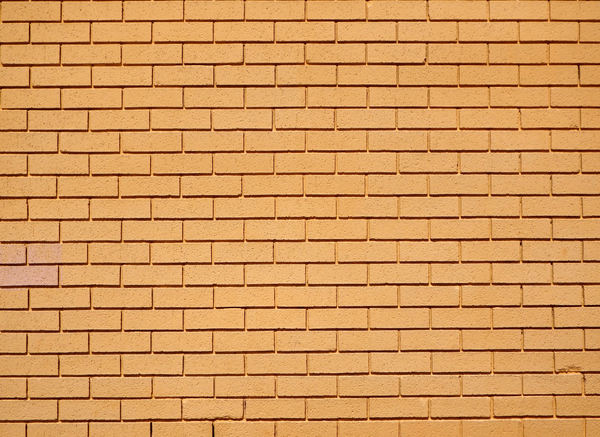 yellow brick wall1: textures of yellow painted brick wall