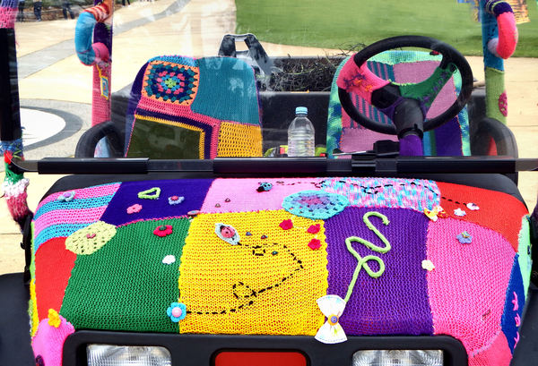 covered wagon2: park utility vehicle displaying colourful knitted cover