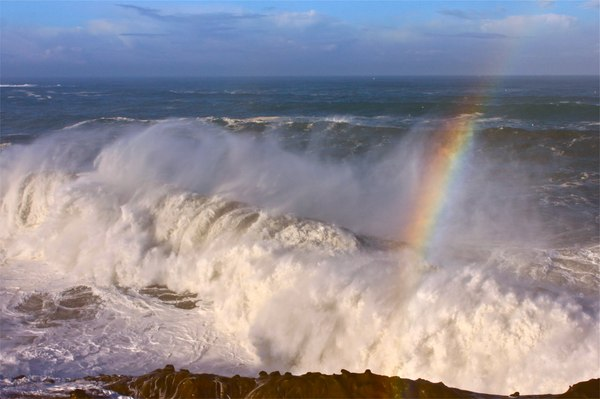 Rainbow over breaking waves