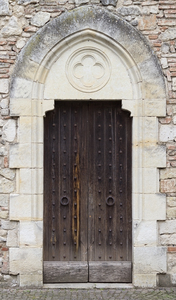Old doors: Side doors to an old church in the Lot/Dordogne area of France.