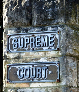 solid justice: name plates identifying supreme court location
